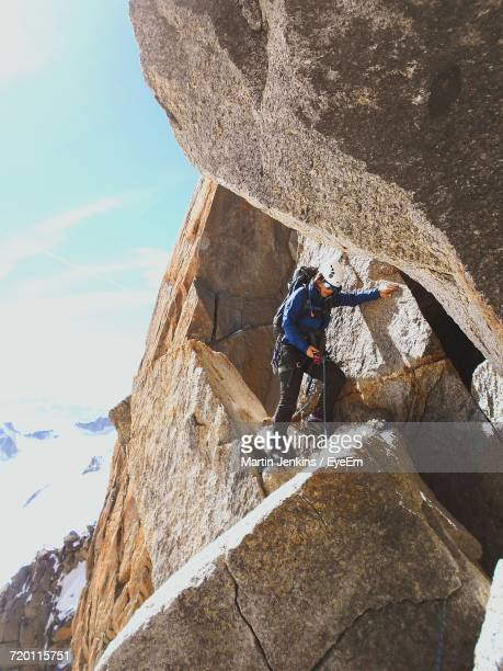 Low Angle View Of Female Climber On Cliff