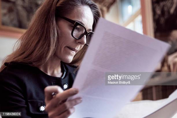 low angle view of female professional analyzing documents at law firm - legal system stock pictures, royalty-free photos & images