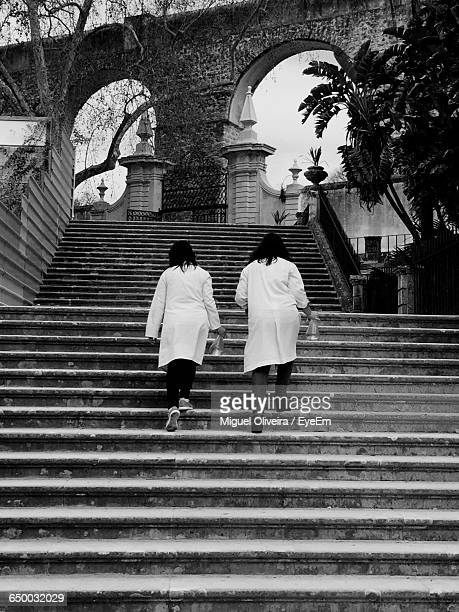 Low Angle View Of Female Scientists On Staircase Leading Towards Laboratory