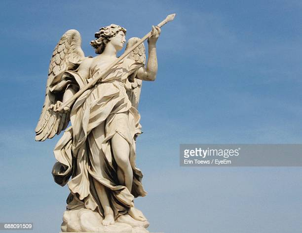 Low Angle View Of Female Statue Against Sky
