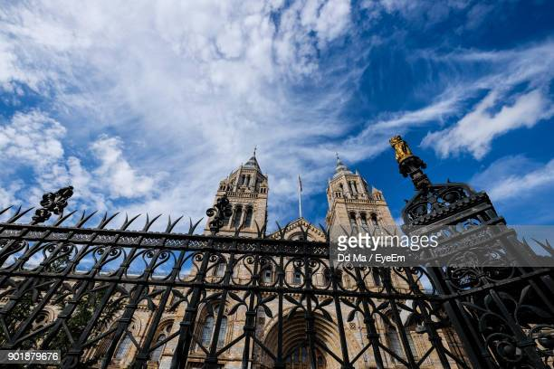 Low Angle View Of Fence By Cathedral Against Sky