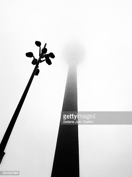 Low Angle View Of Fernsehturm Against Sky During Foggy Weather