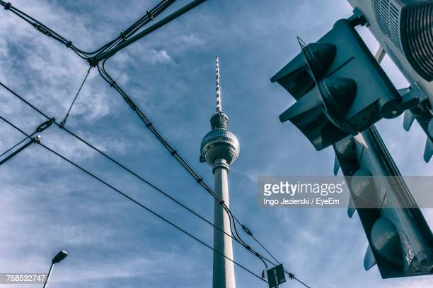 Low Angle View Of Fernsehturm Against Sky During Sunny Day