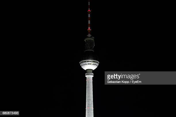 Low Angle View Of Fernsehturm Against Sky In City At Night