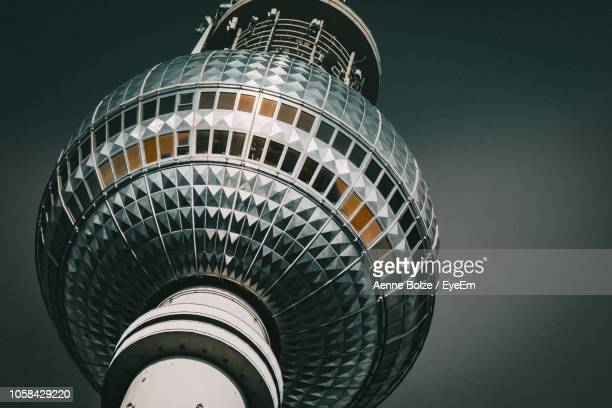 low angle view of fernsehturm against sky - television tower berlin stock pictures, royalty-free photos & images