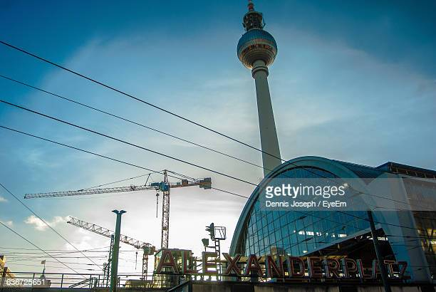 Low Angle View Of Fernsehturm And Alexanderplatz Against Sky