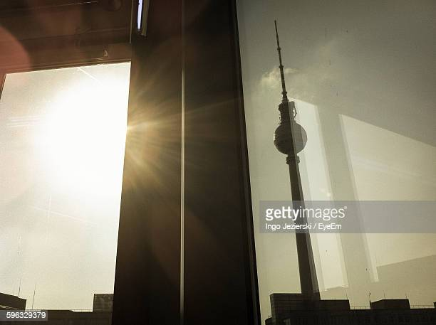 Low Angle View Of Fernsehturm Seen Through Glass Window