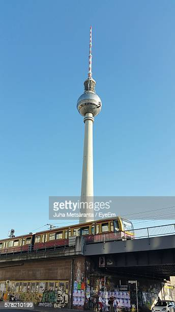 Low Angle View Of Fernsehturm Television Tower Against Clear Sky