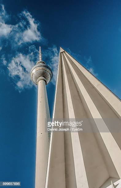 Low Angle View Of Fernsehturm Tower Against Blue Sky