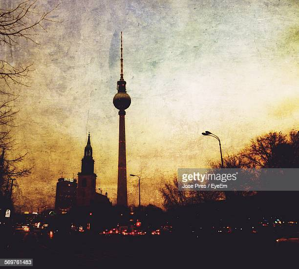 Low Angle View Of Fernsehturm Tower Against Cloudy Sky At Dusk