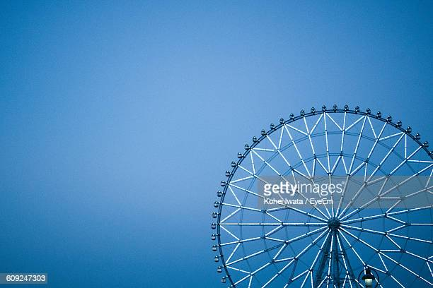 low angle view of ferris wheel against clear blue sky - 観覧車 ストックフォトと画像