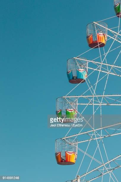 low angle view of ferris wheel against clear blue sky - adelaide festival stock pictures, royalty-free photos & images
