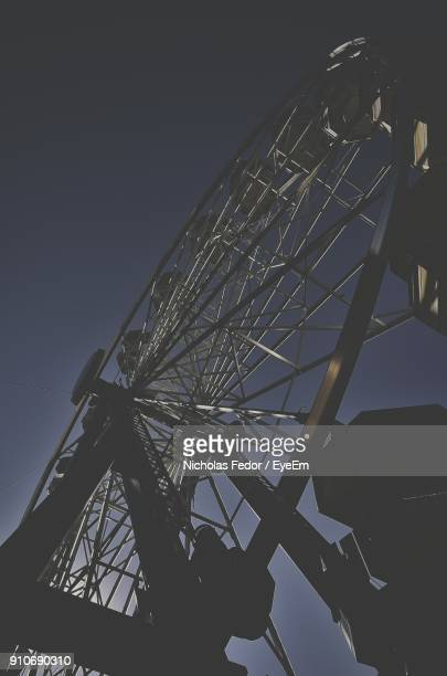 low angle view of ferris wheel against clear sky during sunset - fedor stock pictures, royalty-free photos & images