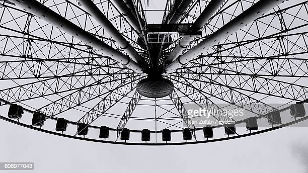 low angle view of ferris wheel against clear sky - iván zoltán stock pictures, royalty-free photos & images