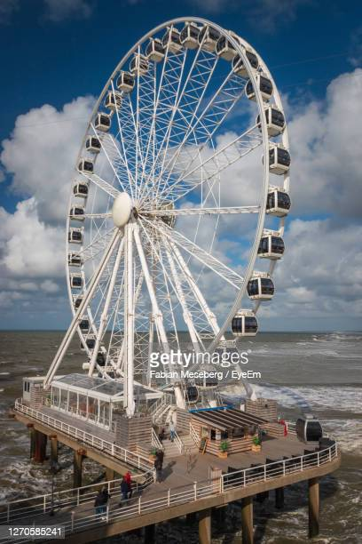 low angle view of ferris wheel against sky - the hague stock pictures, royalty-free photos & images
