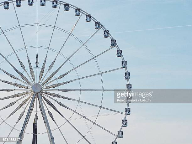 low angle view of ferris wheel against sky - ferris wheel stock pictures, royalty-free photos & images