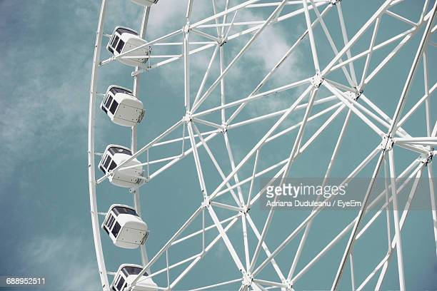 low angle view of ferris wheel against sky - adriana duduleanu stock photos and pictures