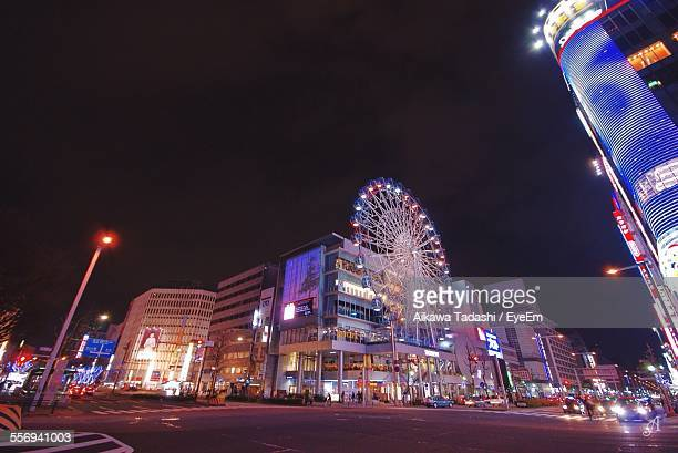 low angle view of ferris wheel at sunshine sakae against sky - aichi prefecture stock pictures, royalty-free photos & images