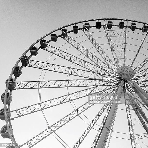 low angle view of ferris wheel - chesterfield square stock-fotos und bilder