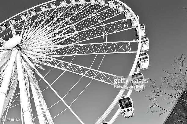 low angle view of ferris wheel - koper stock photos and pictures