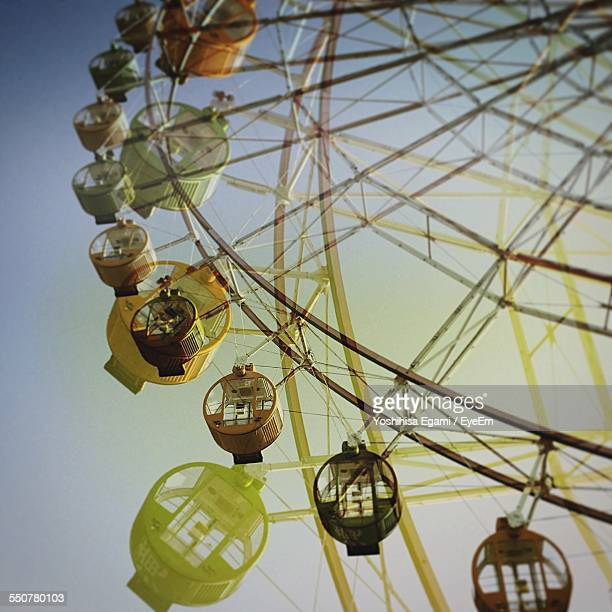 Low Angle View Of Ferris Wheels Against Sky