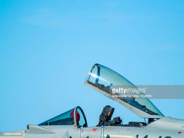 low angle view of fighter plane against clear blue sky - military airplane stock pictures, royalty-free photos & images