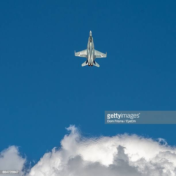 Low Angle View Of Fighter Plane Flying In Sky