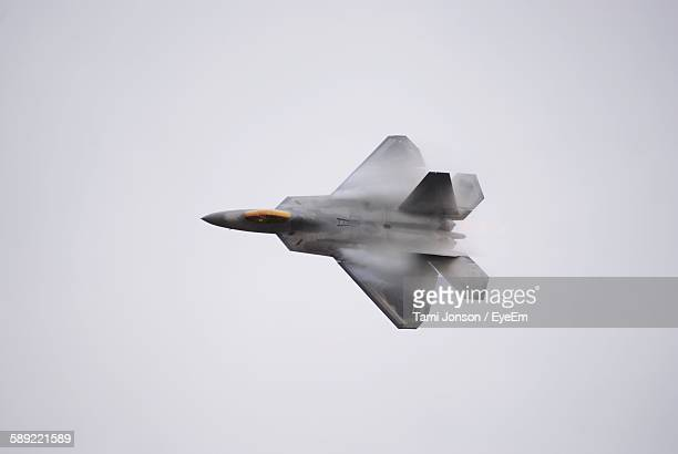 low angle view of fighter plane in mid-air - army stock pictures, royalty-free photos & images