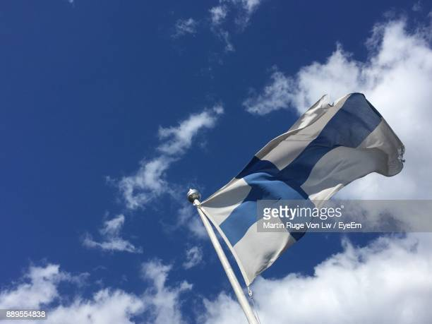 Low Angle View Of Finnish Flag Against Sky