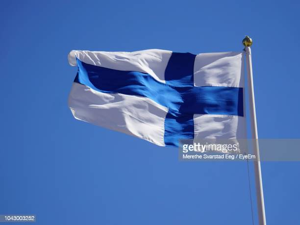 Low Angle View Of Finnish Flag Waving Against Clear Blue Sky