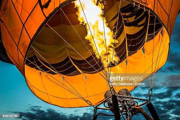 Low Angle View Of Fire Burning In Hot Air Balloon At Dusk