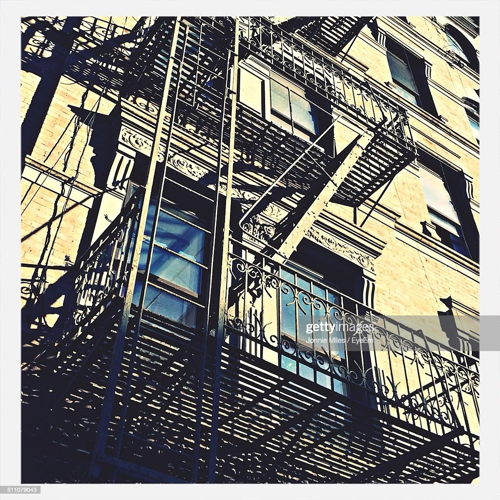 Low angle view of fire escape outside building : Stock Photo