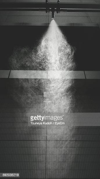 Low Angle View Of Fire Sprinkler Spraying Water