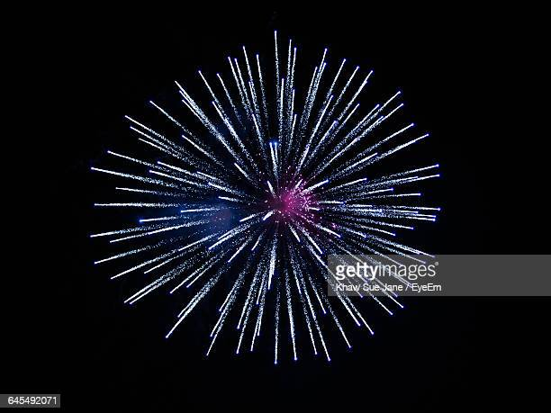 low angle view of firework against sky at night - firework display stock pictures, royalty-free photos & images