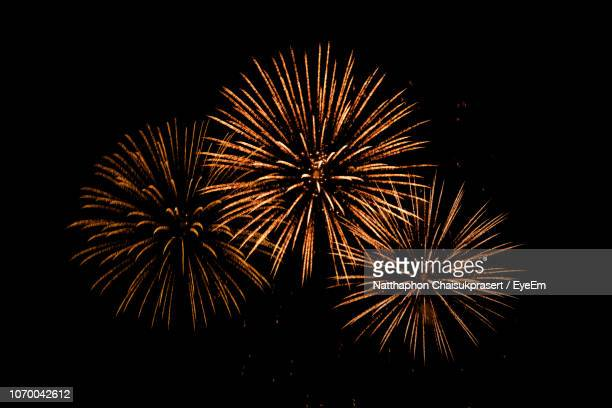 low angle view of firework display against sky at night - firework display stock pictures, royalty-free photos & images