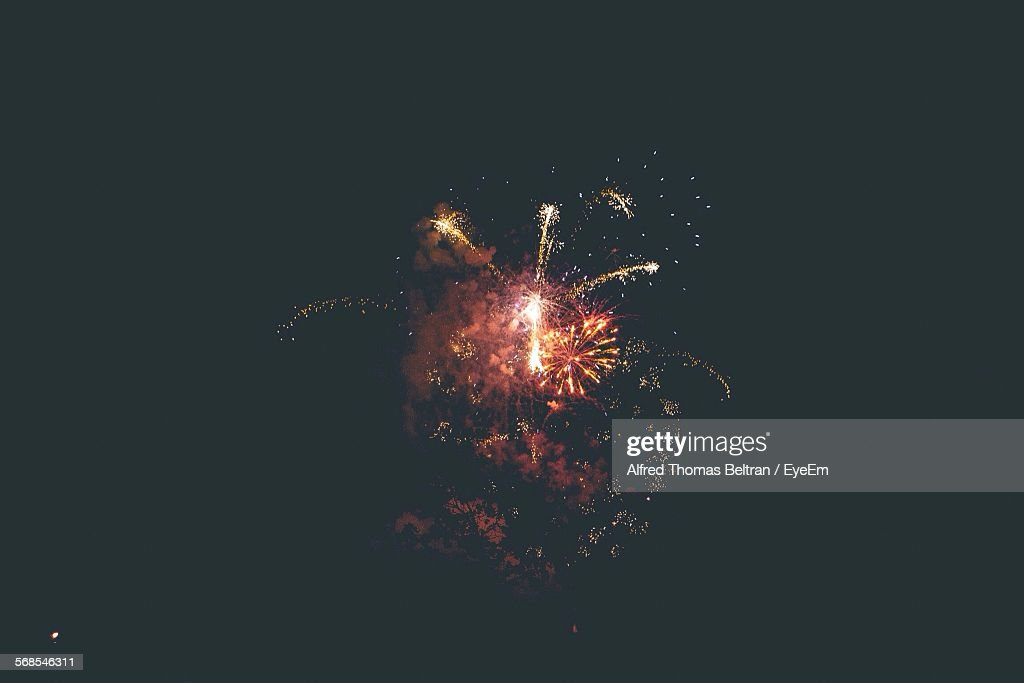 Low Angle View Of Firework Display Against Sky At Night : Stock Photo