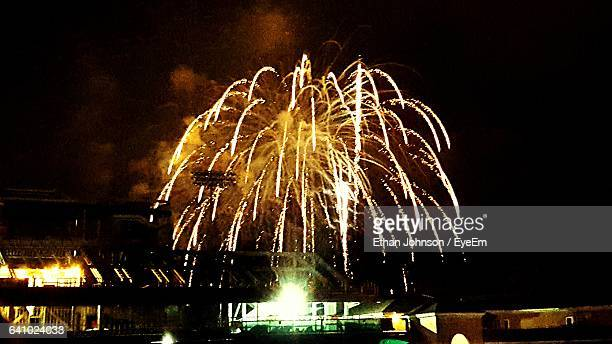low angle view of firework display against sky at night - johnson stockfoto's en -beelden