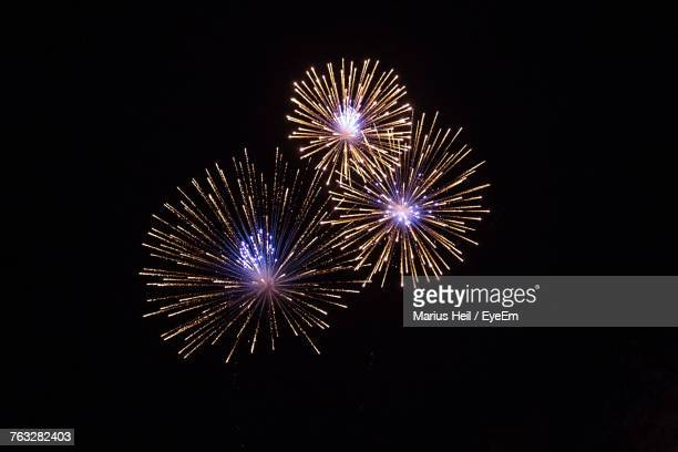 low angle view of firework display against sky at night - fireworks stock pictures, royalty-free photos & images