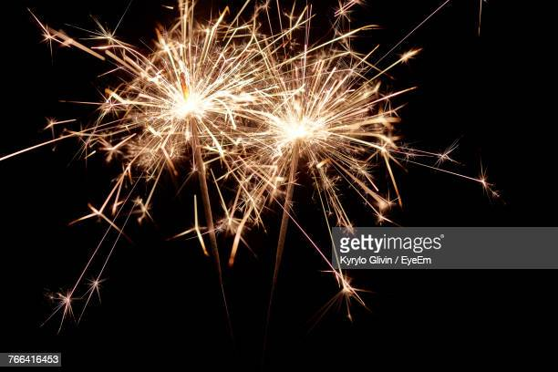 low angle view of firework display against sky at night - sparkler stock pictures, royalty-free photos & images