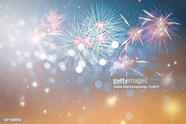 low angle view of firework display at night - countdown stock pictures, royalty-free photos & images