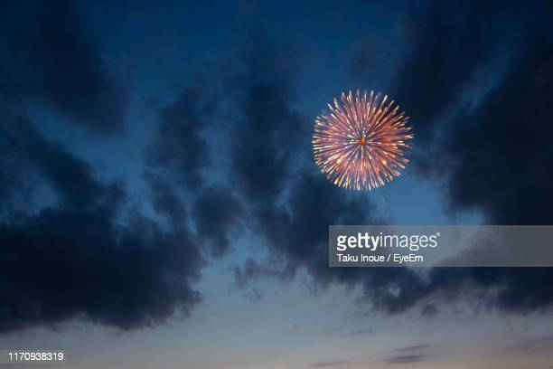 low angle view of firework display at night - inoue stock photos and pictures