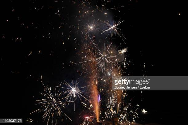 low angle view of firework display at night - idaho falls stock pictures, royalty-free photos & images