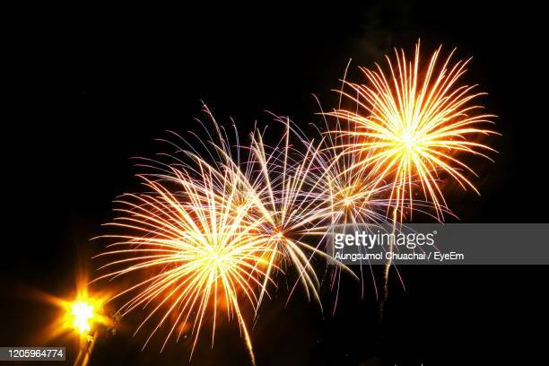 low angle view of firework display at night - aungsumol stock pictures, royalty-free photos & images