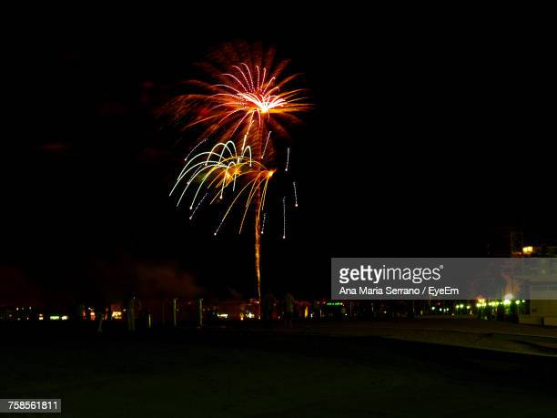 low angle view of firework display at night - castellon province stock pictures, royalty-free photos & images
