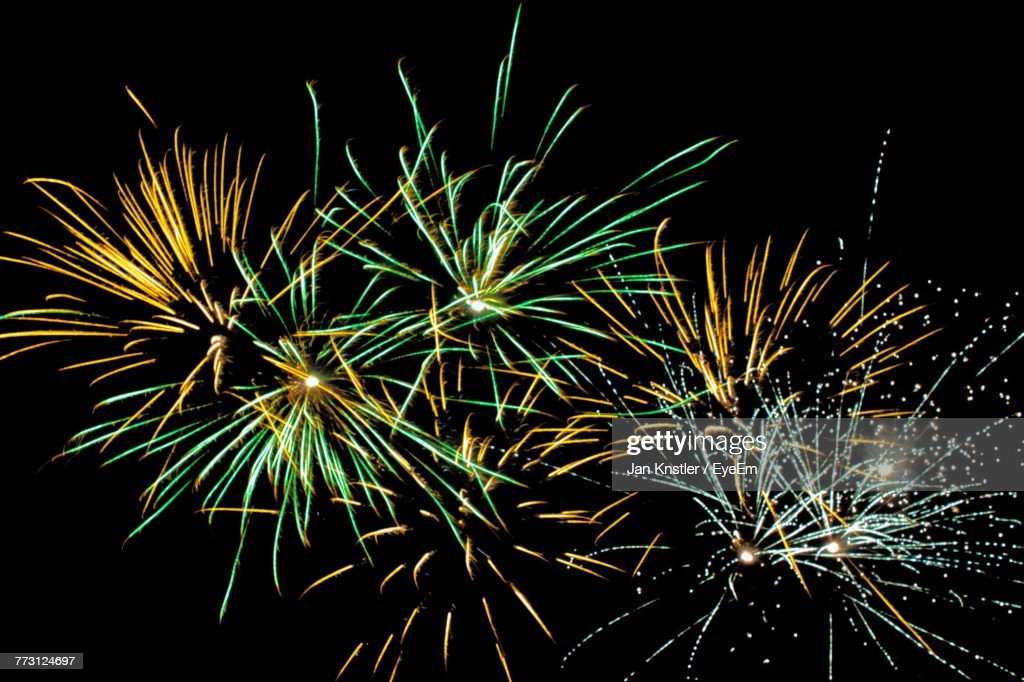 Low Angle View Of Firework Display At Night : Photo