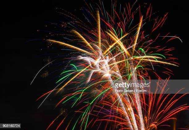 low angle view of firework display at night - florin seitan stock pictures, royalty-free photos & images
