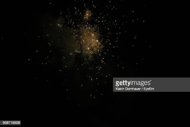 low angle view of firework display at night - sparks stock pictures, royalty-free photos & images