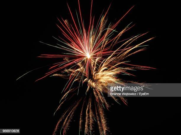 low angle view of firework display at night - brianne stock pictures, royalty-free photos & images