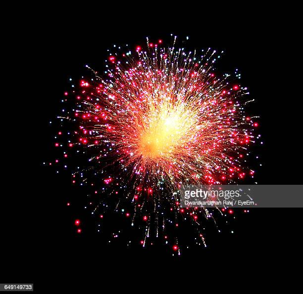Low Angle View Of Firework Display In Clear Sky Night