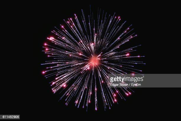 low angle view of firework display in sky at night - fireworks stock pictures, royalty-free photos & images